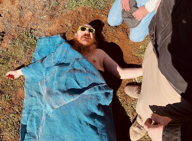 Dusty Trice playing dead on the set of BEAUREGARD (2019).